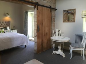 Stables Suite view into bedroom